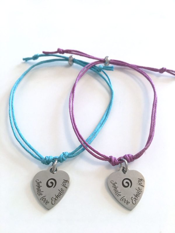 Two bracelets, Inhale Love, Exhale Joy. Stamped Metal bracelet with cord.