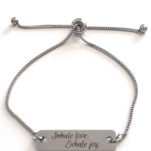 Inhale love exhale joy quote stamped on a metal bar, bracelet with metal chain