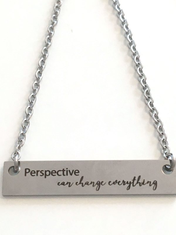 Perspective can change everything stamped necklace on a metal bar